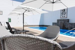 The swimming pool at or near Hotel Chipiona