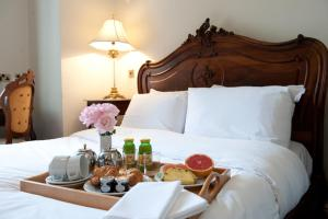 A bed or beds in a room at Beamish Hall Country House Hotel, BW Premier Collection