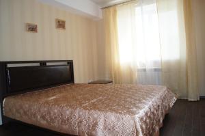 Кровать или кровати в номере Апартаменты Байкал