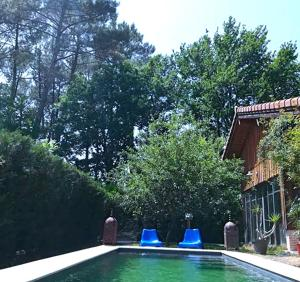 The swimming pool at or near Le Cottage