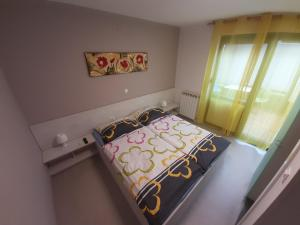 A bed or beds in a room at Apartma & RAfting