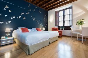 Säng eller sängar i ett rum på Gar Anat Hotel Boutique