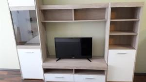 A television and/or entertainment centre at Surman Apartmanok