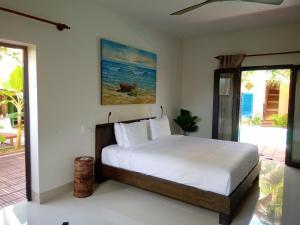 Ein Bett oder Betten in einem Zimmer der Unterkunft MiNhon Hotel Muine