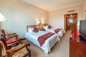 سرير أو أسرّة في غرفة في فندق يانلينغ
