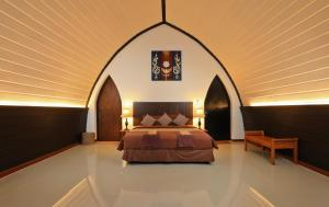 A bed or beds in a room at The Cove Phi Phi