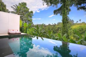 The swimming pool at or near Amora Ubud Boutique Villas