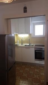 Kuchyň nebo kuchyňský kout v ubytování Apartman Lucijan