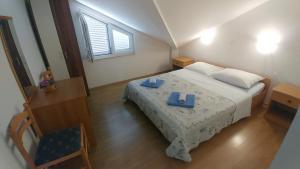 Posteľ alebo postele v izbe v ubytovaní Apartments 3 Palms