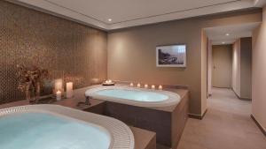 Ein Badezimmer in der Unterkunft Morosani Schweizerhof
