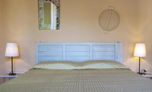 A bed or beds in a room at Hotel Cernia Isola Botanica