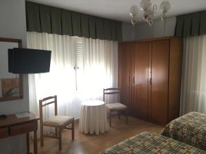 A television and/or entertainment center at Hotel Las Dunas