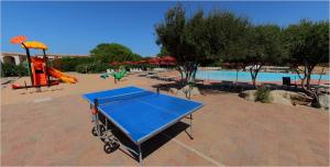 A view of the pool at Club Esse Gallura or nearby