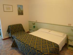 Postel nebo postele na pokoji v ubytování Hotel Firenze