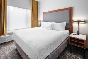 A bed or beds in a room at SpringHill Suites Scottsdale North