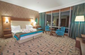 A bed or beds in a room at Margi Hotel