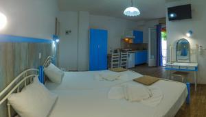 Ένα ή περισσότερα κρεβάτια σε δωμάτιο στο Anthis Studios