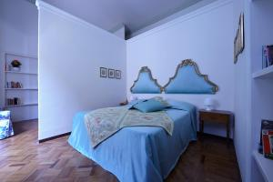 A bed or beds in a room at Le Stanze di Galileo