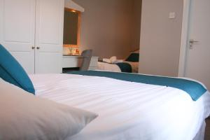 A bed or beds in a room at The Bantry Bay