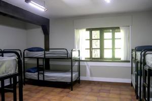 A bunk bed or bunk beds in a room at Albergue de Peregrinos Gerekiz