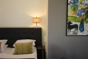 A bed or beds in a room at Margis Hotel & SPA
