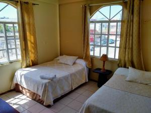 A bed or beds in a room at Mirador Hotel