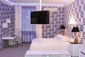 Кровать или кровати в номере Ваш Отель