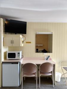 A television and/or entertainment center at Young Goldrush Motel