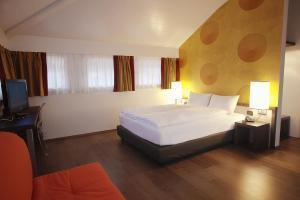Ein Bett oder Betten in einem Zimmer der Unterkunft Hotel Internazionale Bellinzona