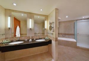 A bathroom at Courtyard by Marriott Dubai, Green Community