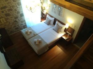 Säng eller sängar i ett rum på D'Argento Boutique Rooms