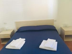 A bed or beds in a room at Albergo Villamarina