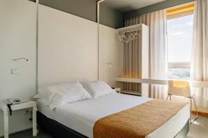 A bed or beds in a room at Basic Braga by Axis