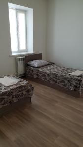 Кровать или кровати в номере Мотель 888