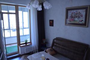 Гостиная зона в Business Apartment on Chernaya reka