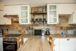 A kitchen or kitchenette at Deluxe Rustic Charlestown Themed Apartment