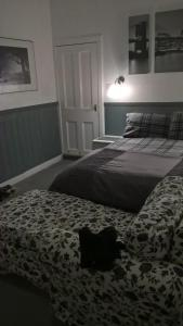 A bed or beds in a room at Nethermains House