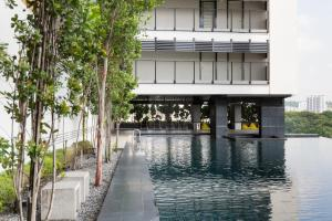 The swimming pool at or close to Flexus Signature by Luxury Suites Asia