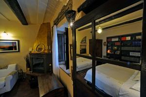 A bunk bed or bunk beds in a room at Locanda Ilune