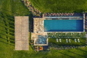 A view of the pool at Follonico 4-Suite B&B or nearby