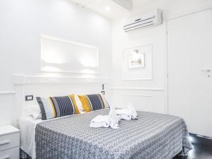 Cama o camas de una habitación en La Locanda di Piazza del Popolo