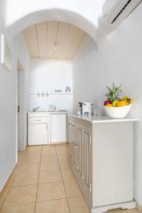 Cuisine ou kitchenette dans l'établissement Ornos Blue