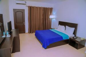 A bed or beds in a room at Riviera Taouyah Hotel