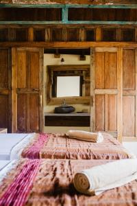 Un ou plusieurs lits dans un hébergement de l'établissement Kalyssa Beach Bungalows