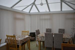 A restaurant or other place to eat at Taldrwst Farmhouse