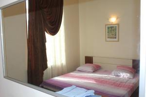 Cama ou camas em um quarto em My Lovely home Akhundov