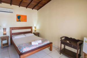 Cama ou camas em um quarto em Geko Pousada Paraty