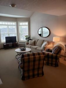 A seating area at Unit 303 Two-Bedroom Condo