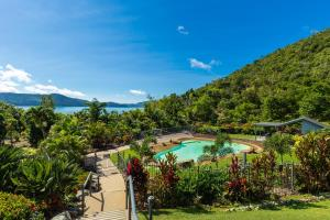 A view of the pool at Frangipani Beachfront Lodge F5 on Hamilton Island by HamoRent or nearby