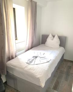 A bed or beds in a room at Zehntscheune Walzbachtal (Wössingen)